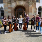 jane-ferguson-with-string-orchestra-members-at-gartmore